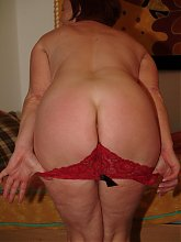 Red mature mama playing with her huge toy