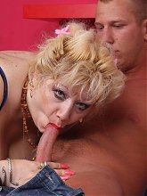 Mature blonde Zhanna shows off her humongous tits and later got herself gooed and screwed