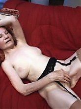 Redhead granny Linda goes for a kinky threesome session and experiences intense fucking
