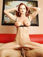 Crystal White is a big boobed mature redhead spread legged and taking a huge black dick inside her box